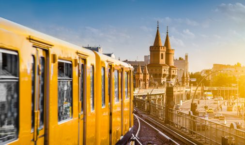 Berliner U-Bahn with famous Oberbaum Bridge in the background in beautiful golden evening light at sunset, Berlin Friedrichshain-Kreuzberg, Germany