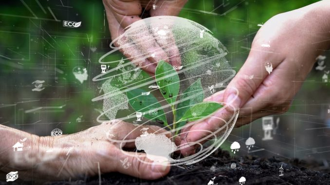 Hands around plant in earth with environmental icons and circle surrounding it