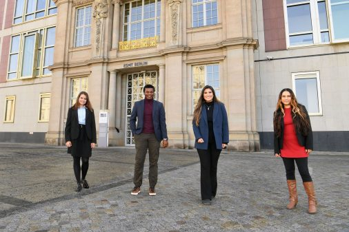 4 MIM students standing in front of ESMT building