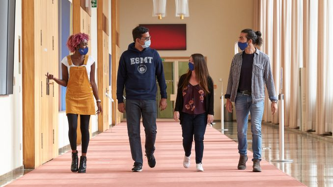 MBA students walking together with masks on