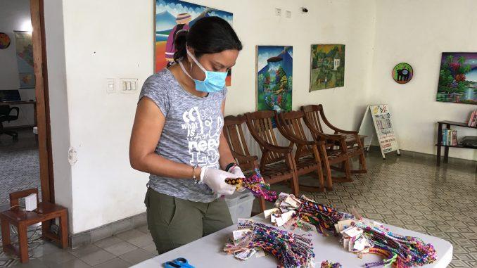 Woman making pulseras