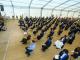 MIM graduates sitting at graduation ceremony